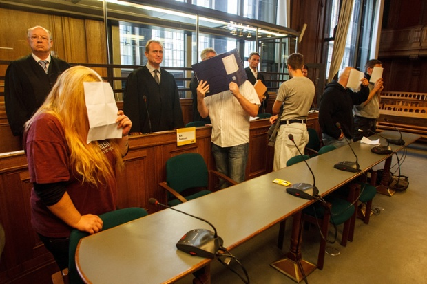 Defendants hide their faces at the starts of court hearing in Berlin against a 10 people accused of jointly operating Irminsul, a neo-Nazi internet radio station. Photograph: Theo Schneider/Demotix/Corbis