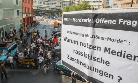 A banner outside the Beate Zschäpe trial asks: Why do the media use racist vocabulary? Photograph: Theo Schneider/ Theo Schneider/Demotix/Corbis