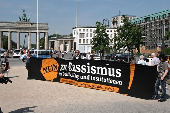 Demonstrators on Tuesday hold an antiracism banner outside the Berlin hotel of Thilo Sarrazin, who in an earlier book claimed Muslim immigrants are dragging down Germany's average intelligence. Photo: Theo Schneider / Corbis